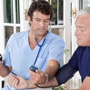 doctor-taking-the-blood-pressure